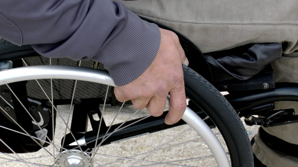 Disabled Man in Wheelchair in court for insurance
