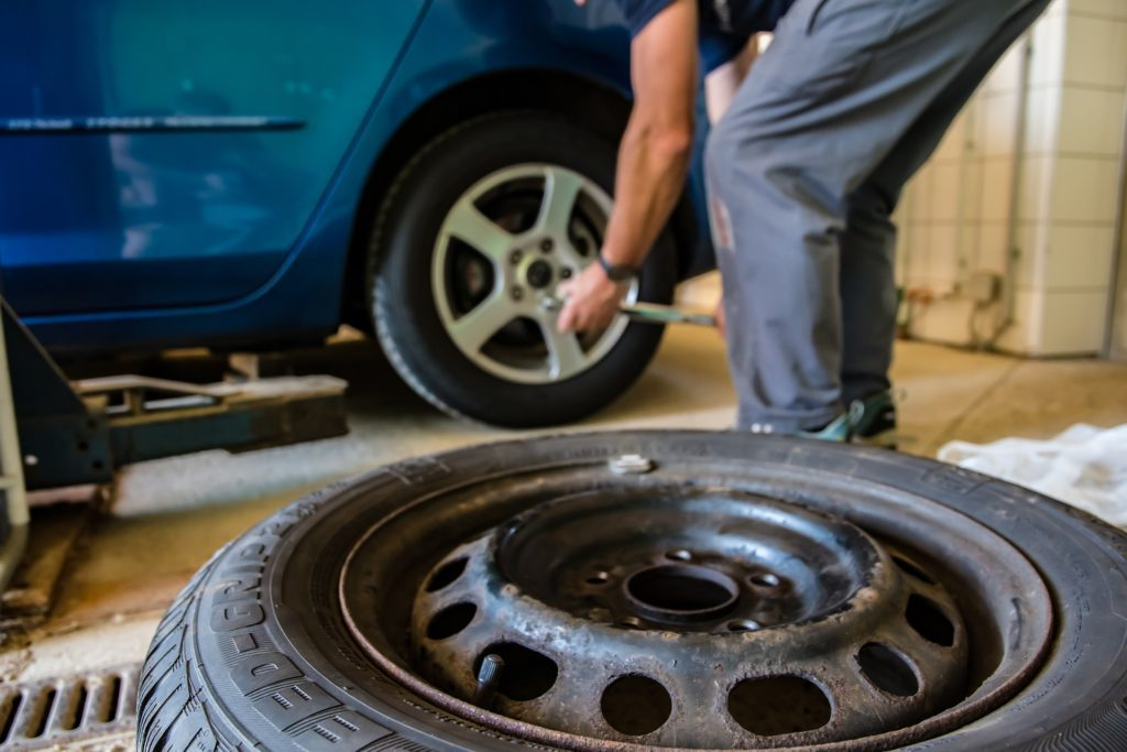 Regular tire maintenance like this is crucial to abide by the motor vehicle act's winter tire regulation